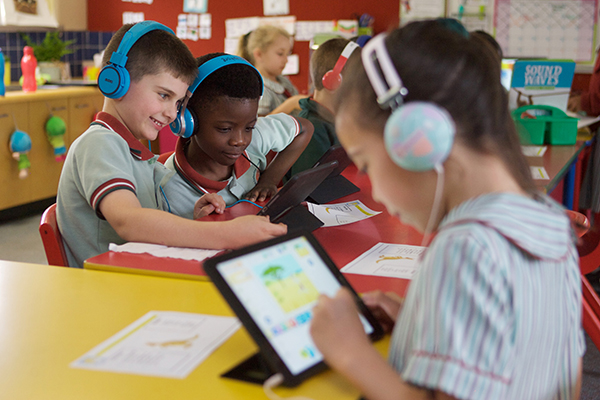 students with headphones on their IPads