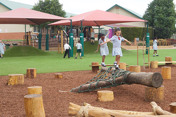 students playing at school playground